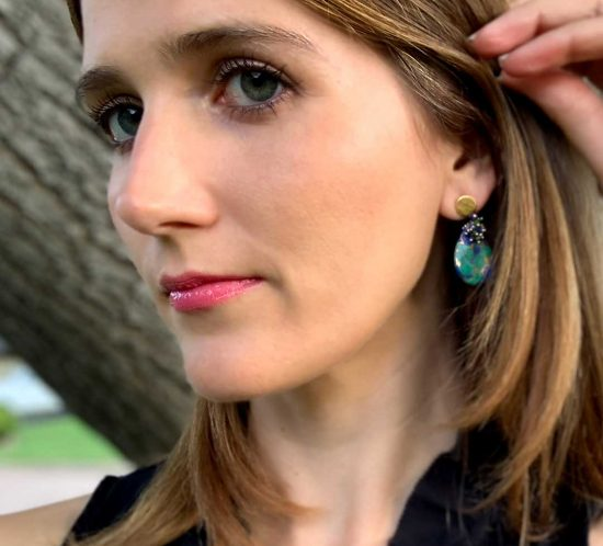 A woman wearing earrings by Dana Busch Designs.