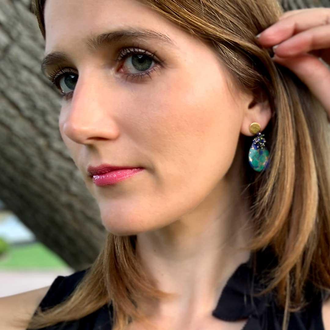 A woman wearing earrings by Dana Busch Designs.