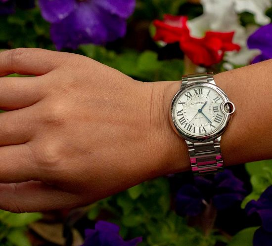 A photo of a woman wearing a Cartier Ballon Bleu Watch sold by DeMesy Fine Watches and Jewelry.